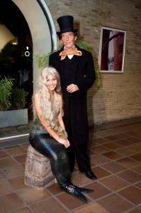 A gentlemen stands next to one of Copenhagen's rogue mermaids